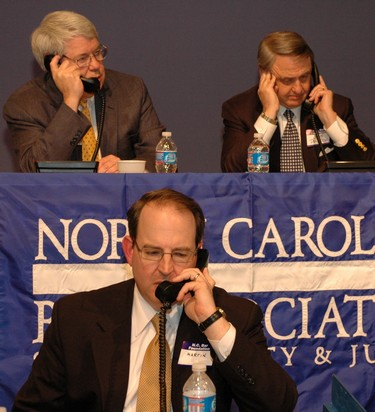 NCBA President-Elect Martin Brinkley, front, Past-President Norfleet, left, and President Gene Pridgen field calls at WRAL-TV.