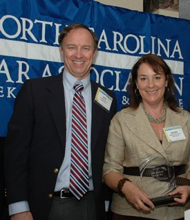 Jim Barrett and Heidi Stewart accept the NCBA's Chief Justice Award on behalf of the 28th Judicial District Bar.
