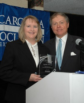 Cynthia Alleman accepts 2010 William l. Thorp Pro Bono Award from NCBA President John Wester.