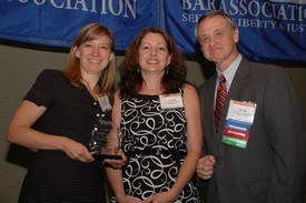 Anna Hamrick, left, and Leah Broker accept the Smaller Firm Pro Bono Service Award from NCBA President Gene Pridgen