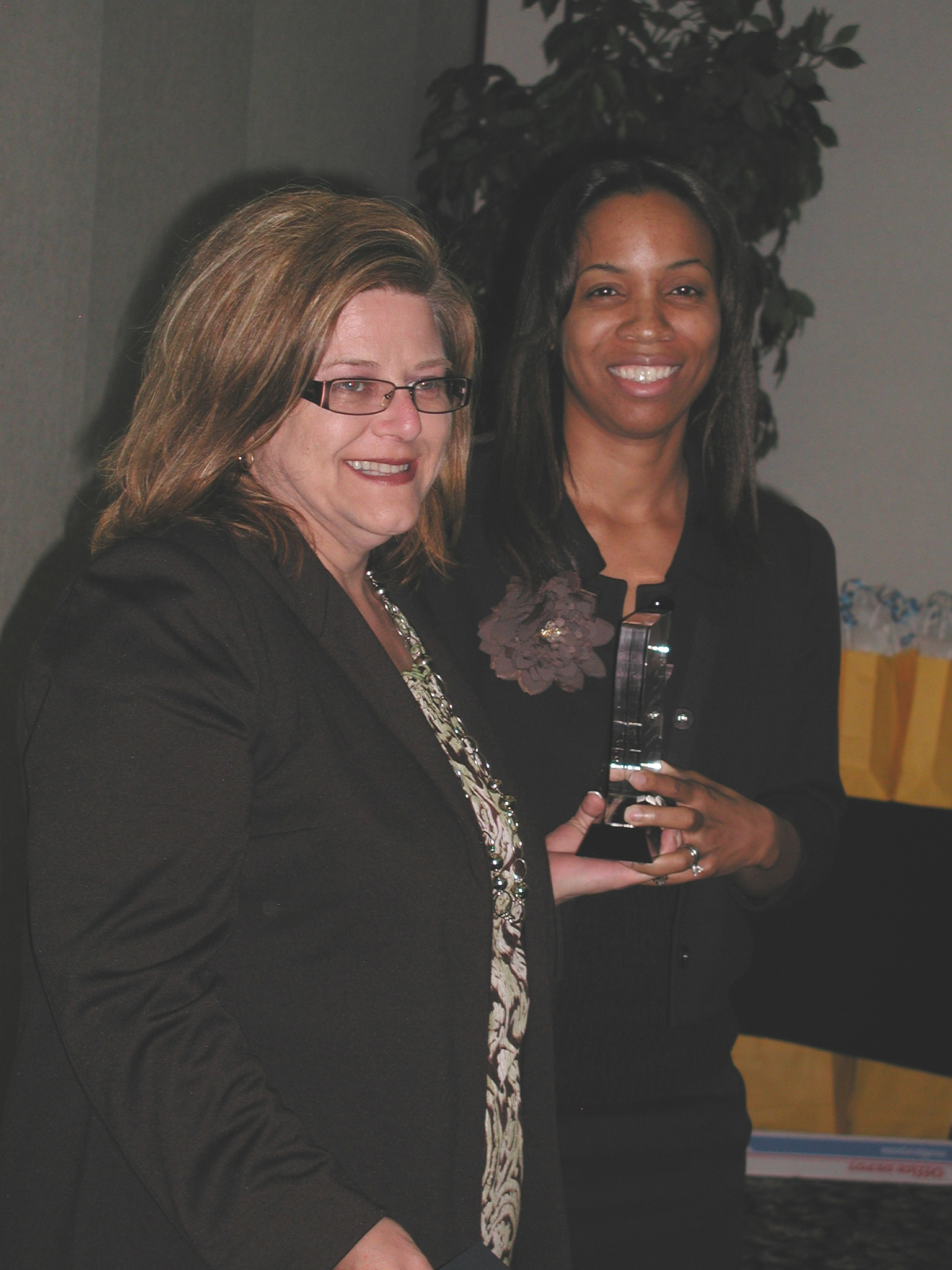 Susan Brotherton, Esq. (receiving Family Law Attorney of Year Rural Counties Award from LANC's Valene Franco)