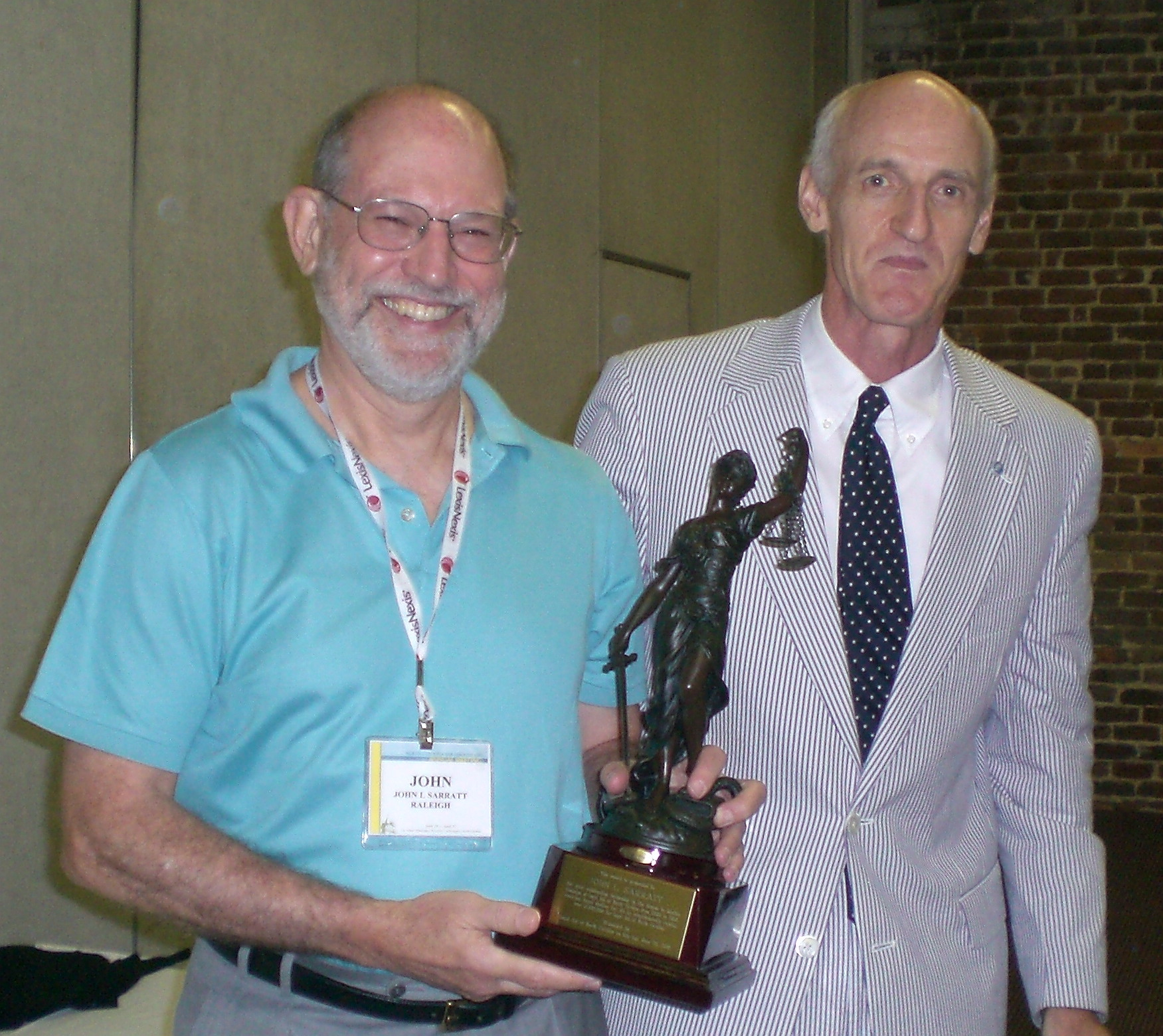 John L. Sarratt (l) accepts award from George Hausen, LANC Executive Director