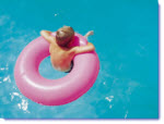 Young child in an innertube in the pool